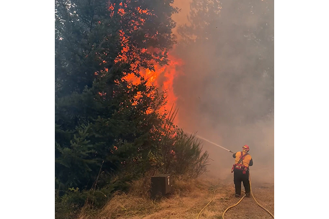 Forest Grove Fire & Rescue members battling wildfire